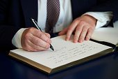 British Foreign Secretary Boris Johnson signs a book of condolence at the French embassy in London on July 20 2016 to commemorate the victims of the...