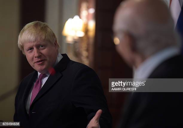 British Foreign Secretary Boris Johnson speaks during a joint press conference with Pakistan's National Security Advisor Sartaj Aziz at the Foreign...