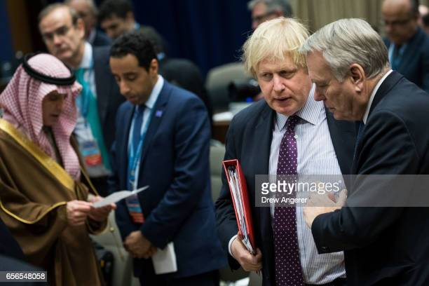 British Foreign Secretary Boris Johnson speaks with French Foreign Minister JeanMarc Ayrault during an afternoon working session with leaders from a...