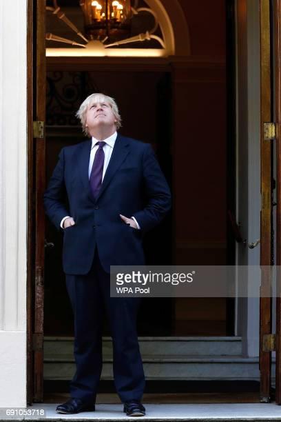 British Foreign Secretary Boris Johnson waits to greet US secretary of state Rex Tillerson outside Carlton Gardens on May 26 2017 in London England...