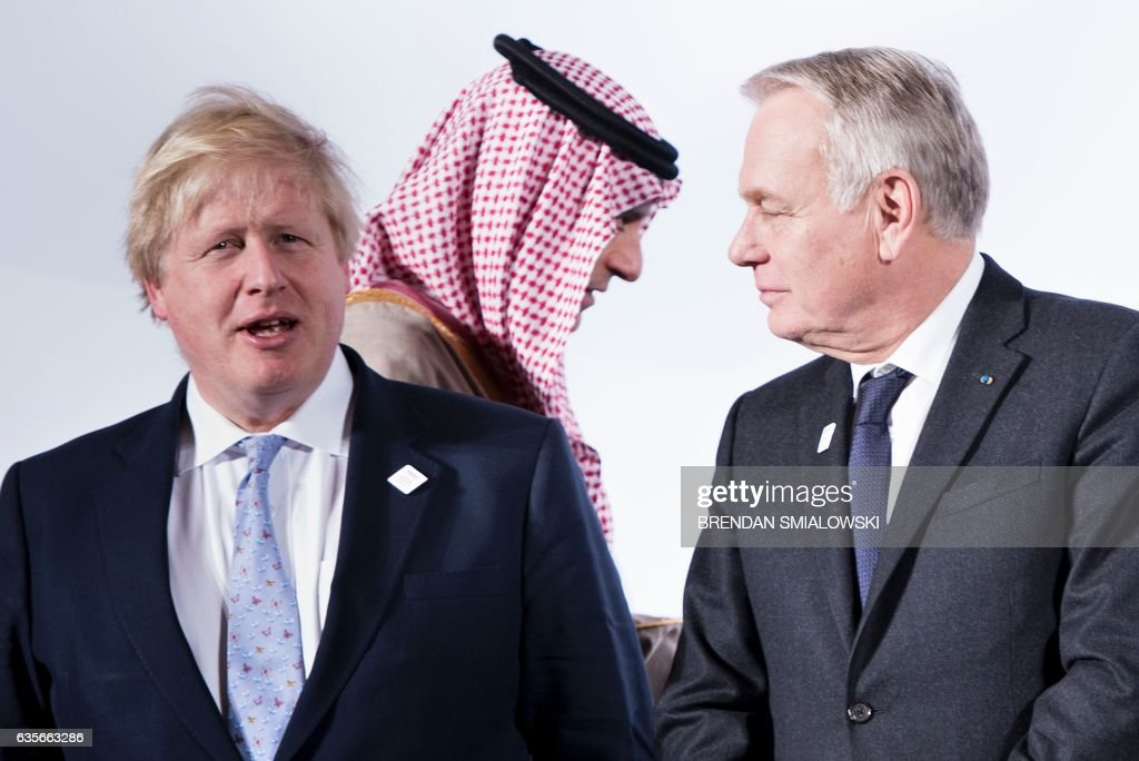 British Foreign Secretary Boris Johnsonn (L) and France's Foreign Minister Jean-Marc Ayrault (R) talk as Saudi Arabia's Foreign Minister Adel bin Ahmed Al-Jubeir arrives for a group photo of G-20 foreign ministers during a meeting at the World Conference Center February 16, 2017 in Bonn, Germany. US Secretary of State Rex Tillerson makes his diplomatic debut at a G20 gathering in Germany on February 16, 2017 where his counterparts hope to find out what 'America First' means for the rest of the world. / AFP / Brendan Smialowski