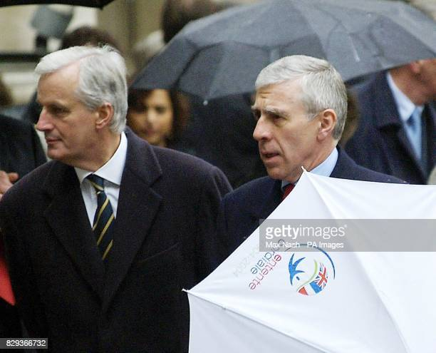 British Foreign Secretary Jack Straw folds his Entente Cordiale umbrella as he walks with his French counterpart Michel Barnier in the courtyard of...
