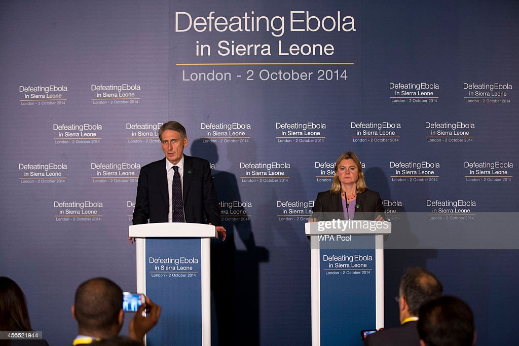 British Foreign Secretary Philip Hammond and British International Development Secretary Justine Greening speak at the 'Defeating Ebola: Sierra Leone' conference at Lancaster House on October 2, 2014 in London, England. Britain hosted an international conference today to help organise the fight against Ebola in its former colony Sierra Leone, as a charity warned that five people were becoming infected every hour in the West African nation.