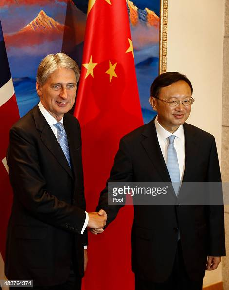 British Foreign Secretary Philip Hammond and Chinese State Councilor Yang Jiechi shake hands and face the media during the ChinaUK Strategic Dialogue...