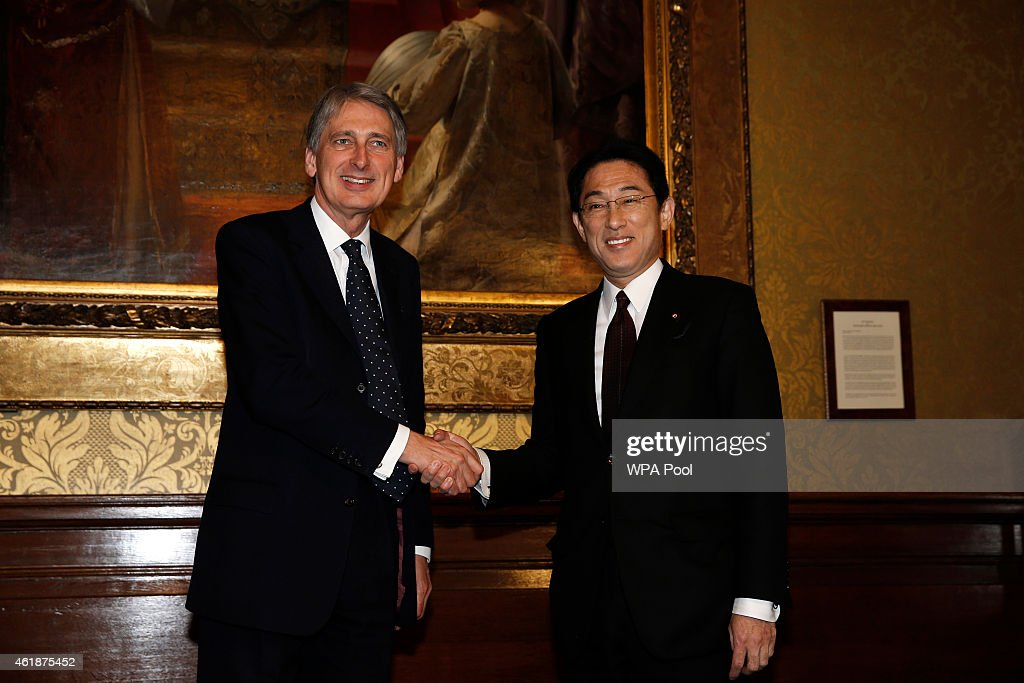 British Foreign Secretary <a gi-track='captionPersonalityLinkClicked' href=/galleries/search?phrase=Philip+Hammond&family=editorial&specificpeople=2486715 ng-click='$event.stopPropagation()'>Philip Hammond</a> (L) and Japanese Foreign Minister <a gi-track='captionPersonalityLinkClicked' href=/galleries/search?phrase=Fumio+Kishida&family=editorial&specificpeople=10093794 ng-click='$event.stopPropagation()'>Fumio Kishida</a> (R) shake hands during a meeting at the Foreign and Commonwealth Office on January 21, 2015 in London, England. The Japanese foreign and defence ministers were in London to meet with their British counterparts, a meeting which was agreed during prime minister Abes visit to the UK in May 2014.