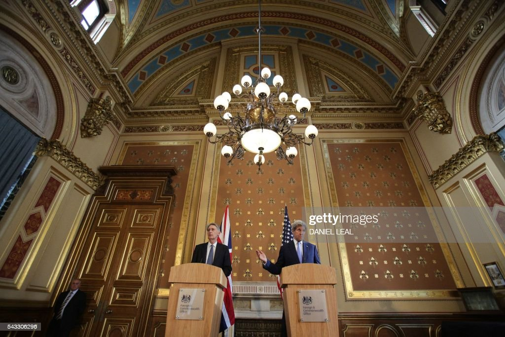 British Foreign Secretary Philip Hammond (L) and US Secretary of State John Kerry (R) hold a joint press conference after their meeting at the Foreign and Commonwealth Office (FCO) in central London on June 27, 2016. US Secretary of State John Kerry urged EU members not to 'lose their head' over the referendum. 'I think it is absolutely essential that we stay focused on how, in this transitional period, nobody loses their head, nobody goes off half cocked, people don't start ginning up scatterbrained or revengeful premises,' he said before heading to London. / AFP / Daniel Leal-Olivas/