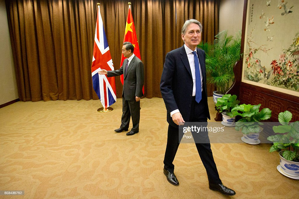 British Foreign Secretary <a gi-track='captionPersonalityLinkClicked' href=/galleries/search?phrase=Philip+Hammond&family=editorial&specificpeople=2486715 ng-click='$event.stopPropagation()'>Philip Hammond</a>, right, walks away after shaking hands with Chinese Foreign Minister <a gi-track='captionPersonalityLinkClicked' href=/galleries/search?phrase=Wang+Yi+-+Homme+politique&family=editorial&specificpeople=13620429 ng-click='$event.stopPropagation()'>Wang Yi</a>, left, as he arrives for a meeting at the Ministry of Foreign Affairson January 5, 2016 in Beijing, China.