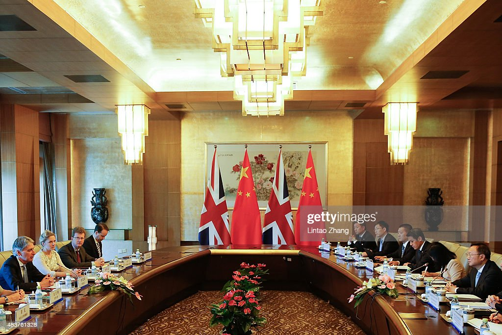 British Foreign Secretary <a gi-track='captionPersonalityLinkClicked' href=/galleries/search?phrase=Philip+Hammond&family=editorial&specificpeople=2486715 ng-click='$event.stopPropagation()'>Philip Hammond</a> (L) speaks with Chinese State Councilor <a gi-track='captionPersonalityLinkClicked' href=/galleries/search?phrase=Yang+Jiechi&family=editorial&specificpeople=555098 ng-click='$event.stopPropagation()'>Yang Jiechi</a> (R) during the China-UK Strategic Dialogue at the Diaoyutai State guesthouse on August 13, 2015 in Beijing, China. <a gi-track='captionPersonalityLinkClicked' href=/galleries/search?phrase=Philip+Hammond&family=editorial&specificpeople=2486715 ng-click='$event.stopPropagation()'>Philip Hammond</a> is in Beijing for a two day visit, his first to China since becoming Foreign Secretary.