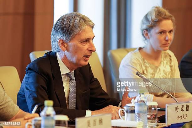 British Foreign Secretary Philip Hammond speaks with Chinese State Councilor Yang Jiechi during the ChinaUK Strategic Dialogue at the Diaoyutai State...