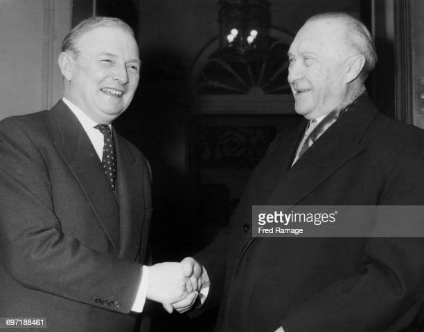 British Foreign Secretary Selwyn Lloyd shakes hands with West German Chancellor Konrad Adenauer on his arrival for lunch at at Lloyd's official...