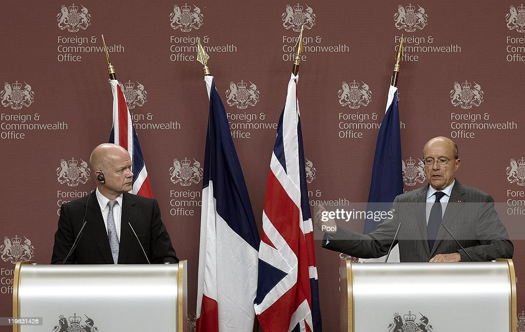 British Foreign, Secretary <a gi-track='captionPersonalityLinkClicked' href=/galleries/search?phrase=William+Hague&family=editorial&specificpeople=206295 ng-click='$event.stopPropagation()'>William Hague</a> (L) and French Minister of Foreign and European Affairs, Alain Juppe (R) address the media during their joint press conference on July 25, 2011 in London, England. Alain Juppe is visiting London to discuss several current international issues including Libya, Syria, Iran, Afghanistan and the Middle-East peace negotiation.