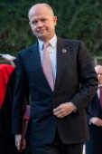 British Foreign Secretary William Hague arrives to attend a meeting of the 'Friends of the Syrian People' attended by US Secretary John Kerry at...