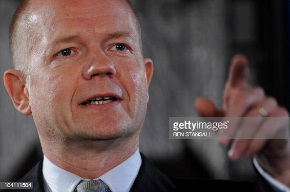 British Foreign Secretary William Hague gestures as he delivers a speech entitled 'Britain's Values in a Networked World' in London on September 15...