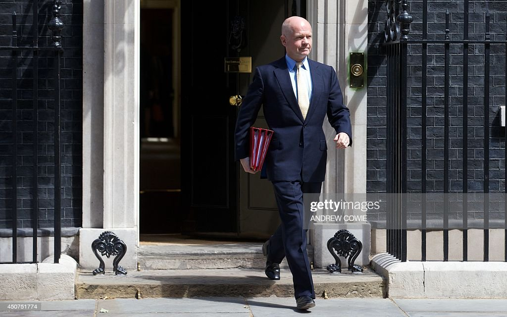 British Foreign Secretary <a gi-track='captionPersonalityLinkClicked' href=/galleries/search?phrase=William+Hague&family=editorial&specificpeople=206295 ng-click='$event.stopPropagation()'>William Hague</a> leaves number 10 Downing Street in London on June 17, 2014 as he leaves to address parliament. Britain plans to reopen its embassy in Iran, Foreign Secretary <a gi-track='captionPersonalityLinkClicked' href=/galleries/search?phrase=William+Hague&family=editorial&specificpeople=206295 ng-click='$event.stopPropagation()'>William Hague</a> announced on June 17, as the West steps up its engagement with Tehran amid rapid jihadist advances in neighbouring Iraq. AFP PHOTO / ANDREW COWIE