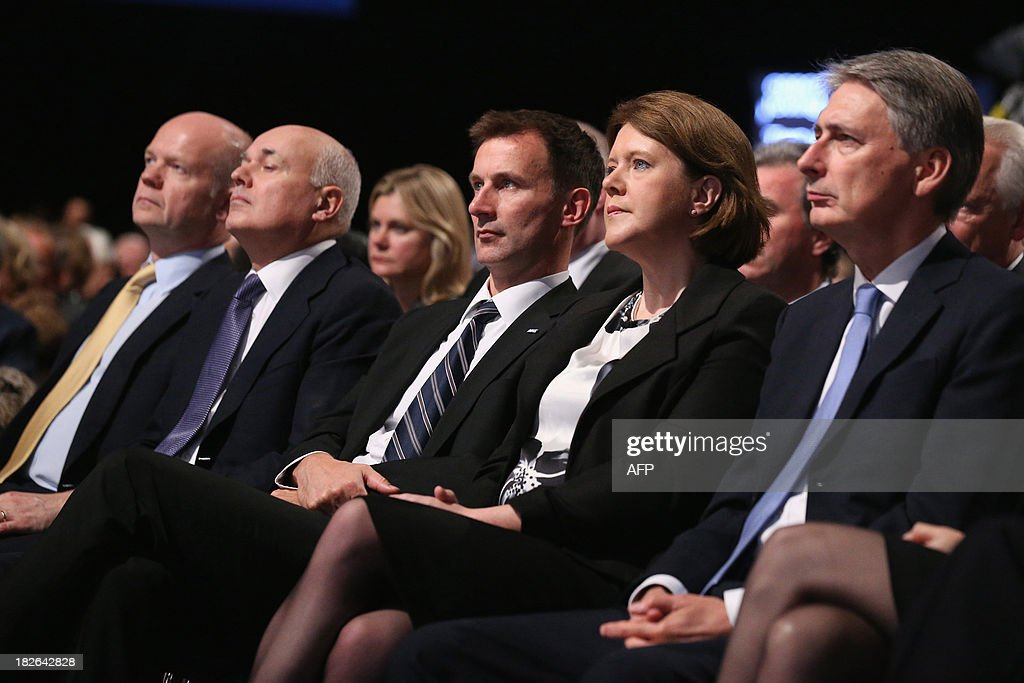 British Foreign Secretary William Hague, Work & Pensions Secretary Iain Duncan Smith, Health Secretary Jeremy Hunt, Culture Secretary Maria Miller and Defence Secretary Philip Hammond listen as British Prime Minister David Cameron addresses delegates at the annual Conservative Party Conference in Manchester, north-west England, on October 2, 2013.