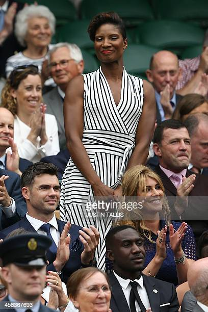 British former athlete Denise Lewis stands in the royal box on centre court as she is introduced on the sixth day of the 2016 Wimbledon Championships...