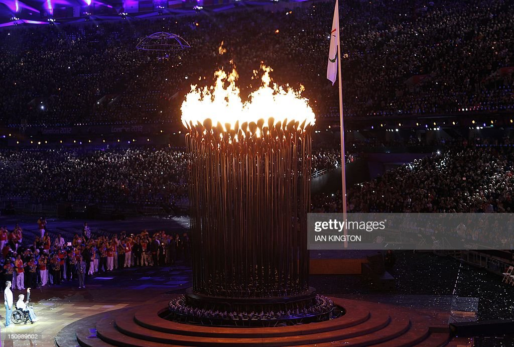 British former Paralympian Margaret Maughan (L) looks on after lighting the cauldron bearing the Paralympic Flame at the opening ceremony of the London 2012 Paralympic Games at the Olympic Stadium in east London on August 29, 2012. AFP PHOTO / IAN KINGTON