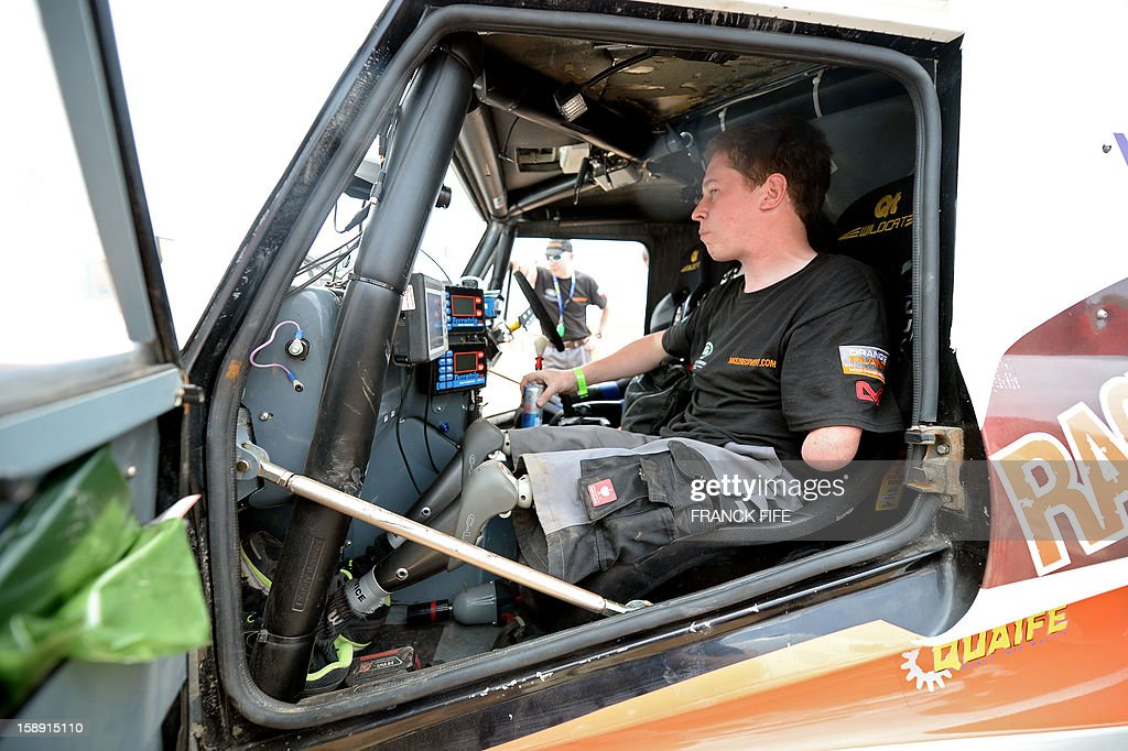 British former paratrooper Thomas Neathway, victim of a trap which earned him the amputation of both legs and an arm, member of the team Race 2 Recovery of British and American soldiers who have suffered serious injuries in the conflicts in Iraq and Afghanistan in recent years, waits in his car in Lima on January 3, 2013, ahead of the 2013 Dakar Rally which this year will thunder through Peru, Argentina and Chile from January 5 to 20.
