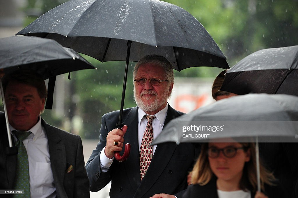 British former radio presenter Dave Lee Travis (C) arrives at the Old Bailey court in central London on September 6, 2013 for a hearing on charges of indecent and sexual assault. Travis was arrested on November 15, 2012 as part of a police investigation into allegations of sexual offences against his late colleague Jimmy Savile. The charges of indecent assault relate to eight women aged between 15 and 29. Travis has consistently denied any wrongdoing.