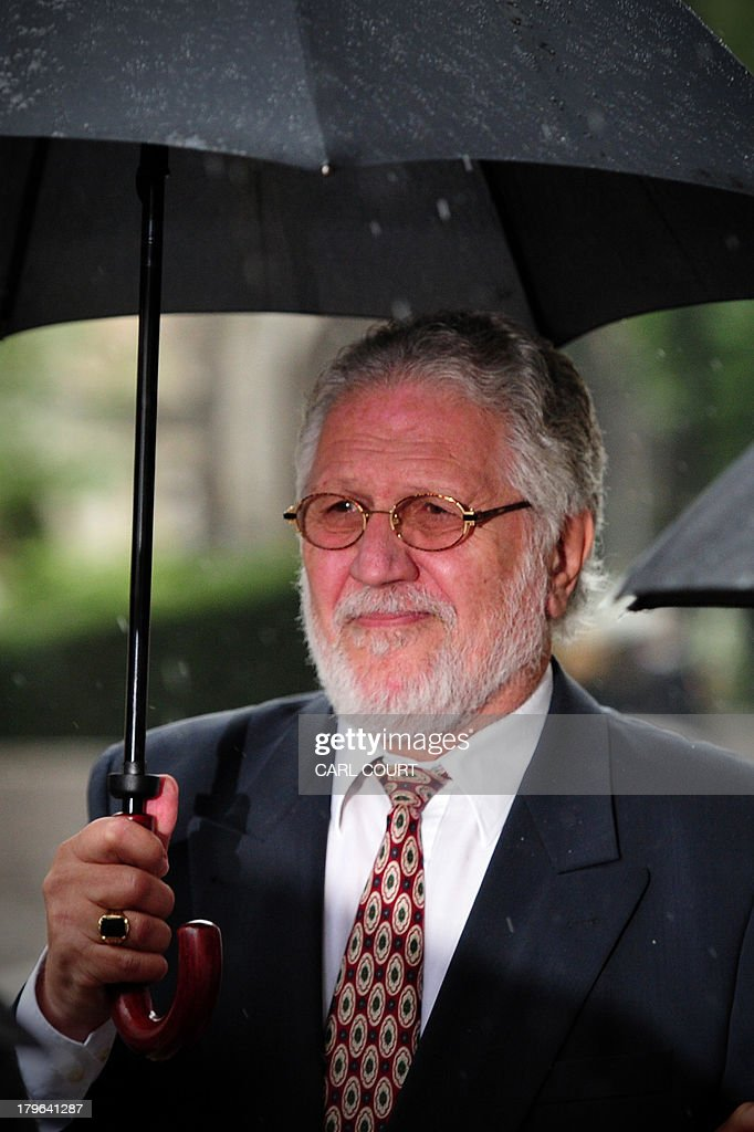 British former radio presenter Dave Lee Travis arrives at the Old Bailey court in central London on September 6, 2013 for a hearing on charges of indecent and sexual assault. Travis was arrested on November 15, 2012 as part of a police investigation into allegations of sexual offences against his late colleague Jimmy Savile. The charges of indecent assault relate to eight women aged between 15 and 29. Travis has consistently denied any wrongdoing. AFP PHOTO/CARL COURT