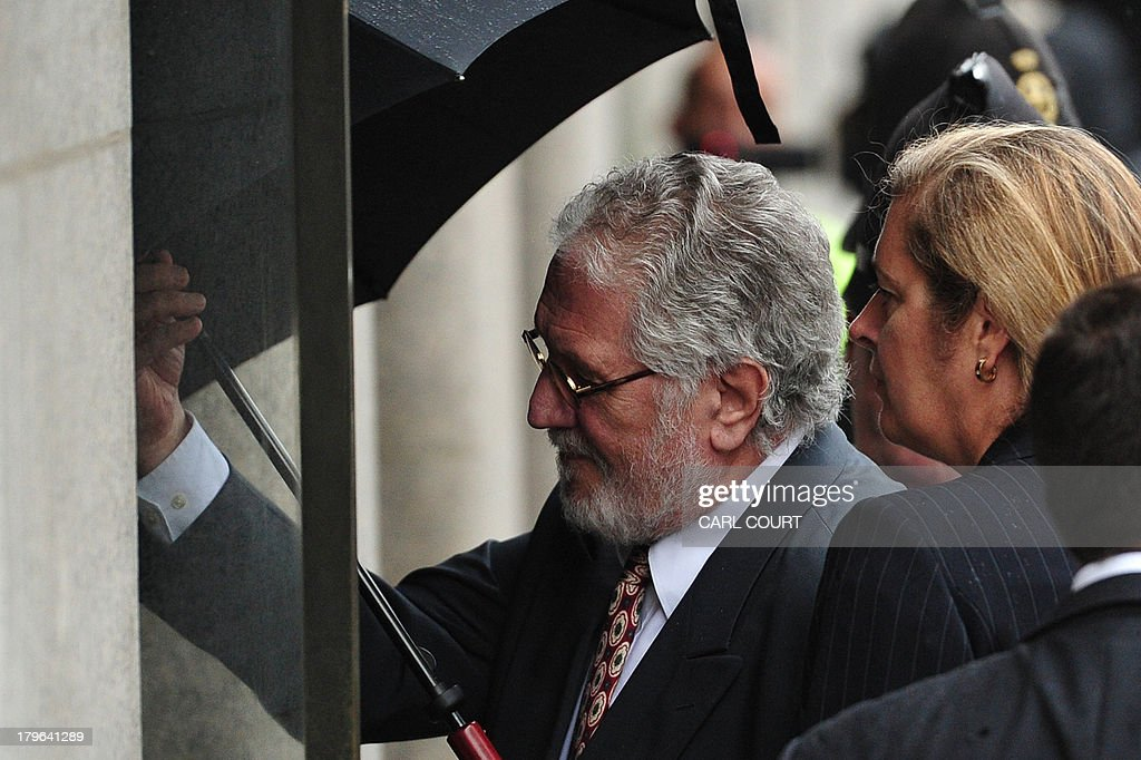 British former radio presenter Dave Lee Travis arrives at the Old Bailey court in central London on September 6, 2013 for a hearing on charges of indecent and sexual assault. Travis was arrested on November 15, 2012 as part of a police investigation into allegations of sexual offences against his late colleague Jimmy Savile. The charges of indecent assault relate to eight women aged between 15 and 29. Travis has consistently denied any wrongdoing.