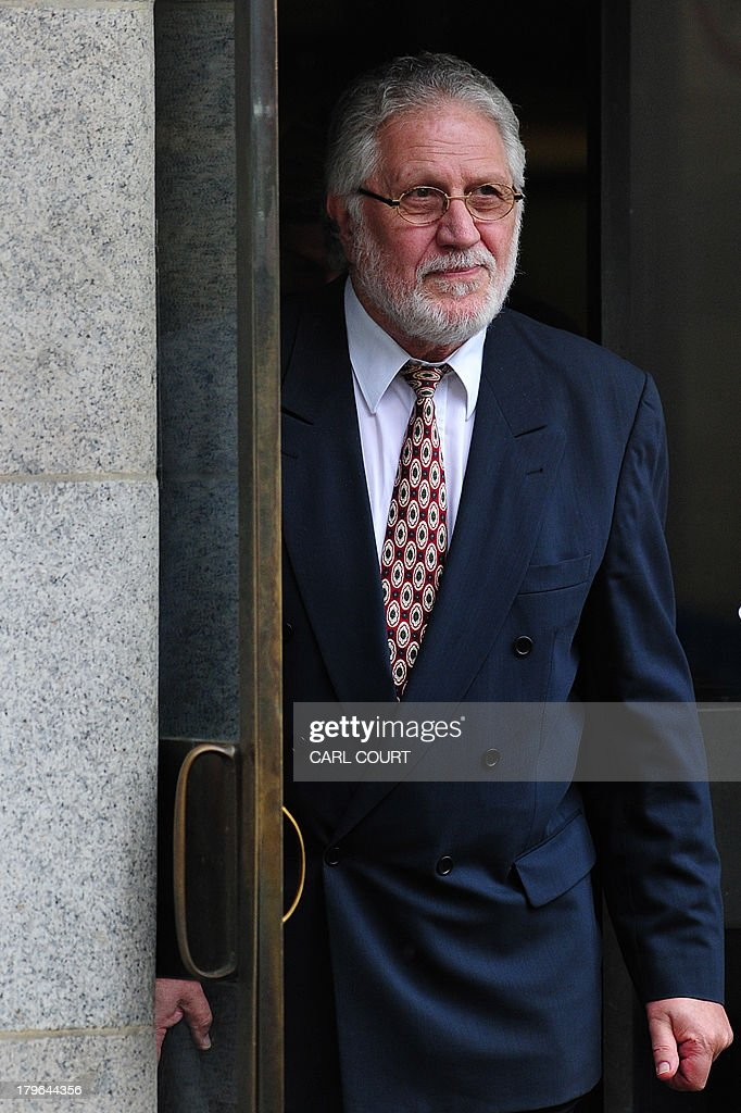British former radio presenter Dave Lee Travis leaves the Old Bailey court in central London on September 6, 2013 after a hearing on charges of indecent and sexual assault. Travis was arrested on November 15, 2012 as part of a police investigation into allegations of sexual offences against his late colleague Jimmy Savile. The charges of indecent assault relate to eight women aged between 15 and 29. Travis has consistently denied any wrongdoing. AFP PHOTO/CARL COURT