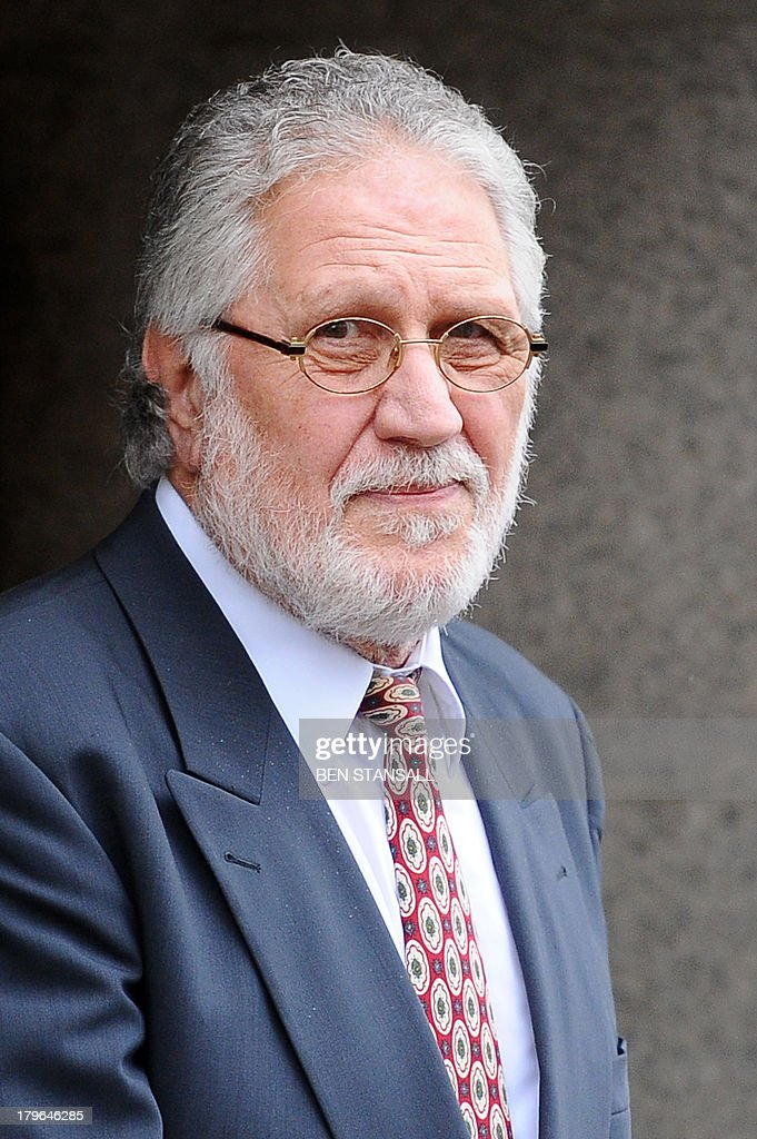British former radio presenter Dave Lee Travis leaves the Old Bailey court in central London on September 6, 2013 after a hearing on charges of indecent and sexual assault. Travis was arrested on November 15, 2012 as part of a police investigation into allegations of sexual offences against his late colleague Jimmy Savile. The charges of indecent assault relate to eight women aged between 15 and 29. Travis has consistently denied any wrongdoing.