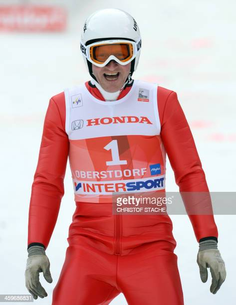 British former ski jumper Michael Edwards known as Eddie 'The Eagle' reacts during the FourHillsTournament in Oberstdorf southern Germany on December...