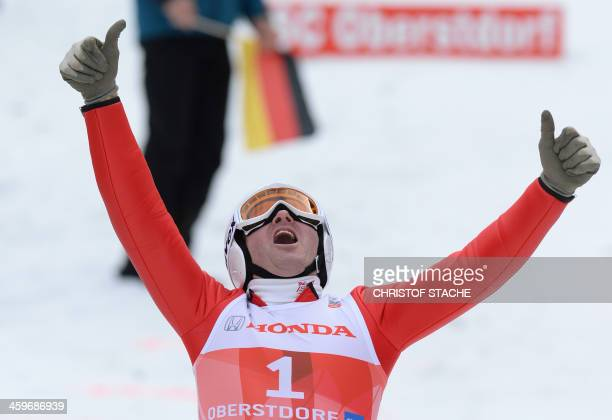British former ski jumper Michael Edwards known as Eddie 'The Eagle' reacts after jumping for fun during the FourHillsTournament in Oberstdorf...