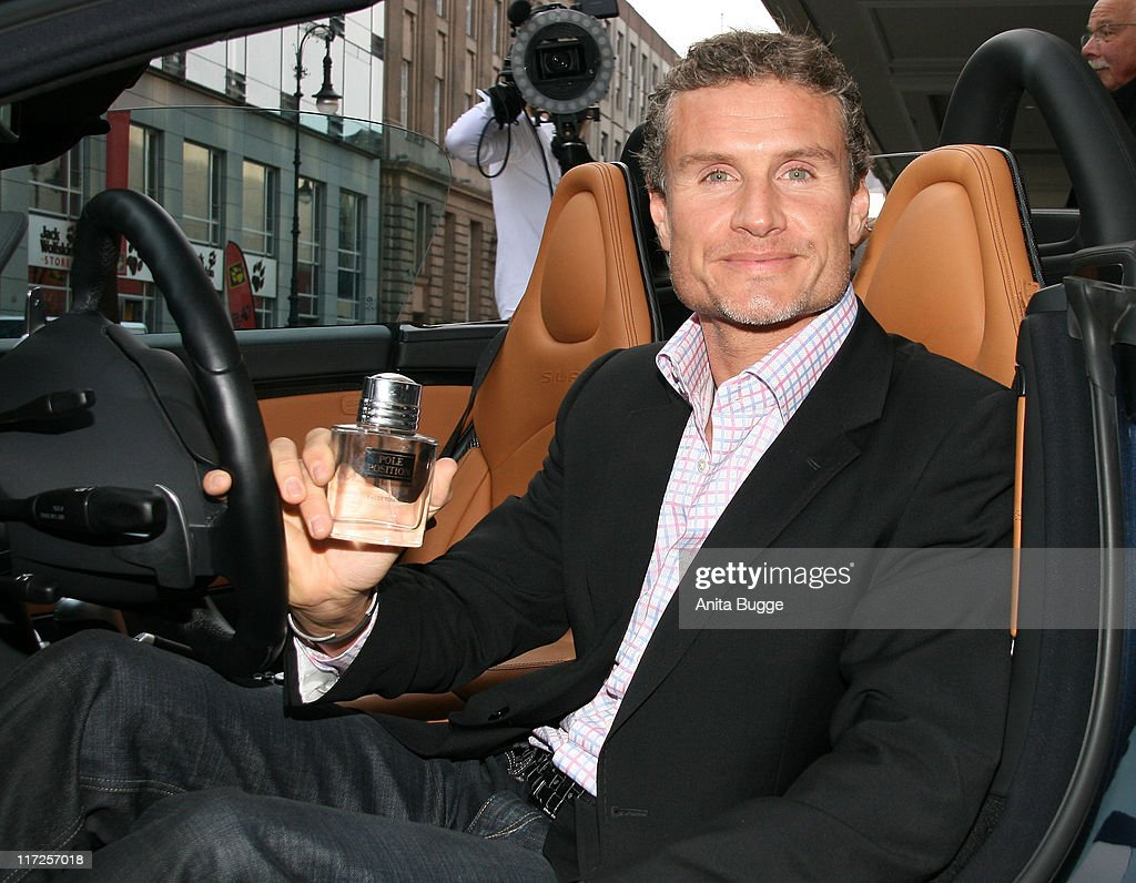 British Formula One driver <a gi-track='captionPersonalityLinkClicked' href=/galleries/search?phrase=David+Coulthard&family=editorial&specificpeople=171316 ng-click='$event.stopPropagation()'>David Coulthard</a> poses in a Mercedes McLAren SLR Roadster during a photcall to promote his fragrance Pole Position on October 29, 2007 in Berlin, Germany.