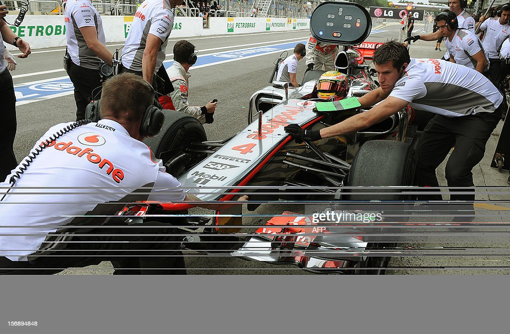 British Formula One driver Lewis Hamilton adjusts his McLaren at the pits on November 24, 2012 during the free practices for the Brazilian GP on Sunday at the Interlagos racetrack in Sao Paulo, Brazil. AFP PHOTO