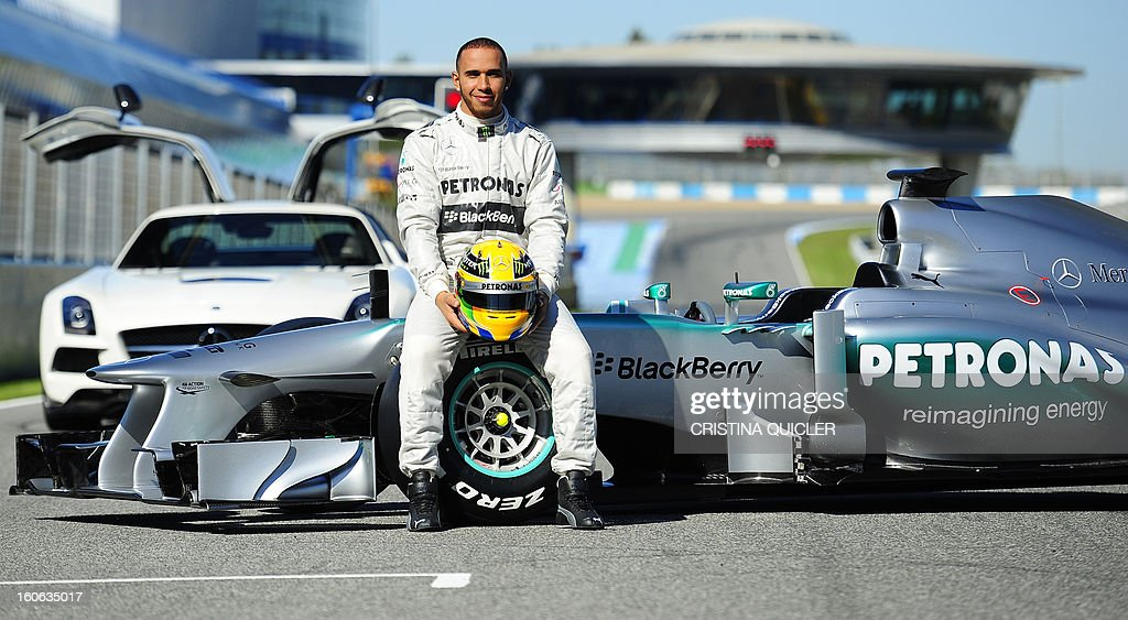 British Formula One driver Lewis Hamilton (L) poses with the new Mercedes W04 as part of the Formula One training session at Jerez racetrack, on February 4, 2013 in Jerez de la Frontera.