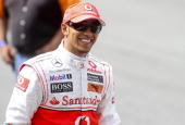 British Formula One driver Lewis Hamilton smiles during an event to race against a new Vodacom internet cable transferring 54 GB of data at Kyalami...