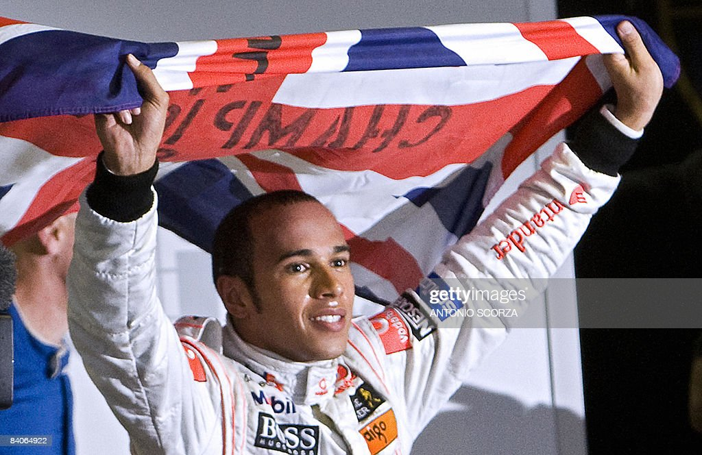'ANNEE SPORTIVE 2008 - EN 2009 LA F1 FAIT SA REVOLUTION, ENCORE UNE FOIS' - (FILES) - British Formula One driver <a gi-track='captionPersonalityLinkClicked' href=/galleries/search?phrase=Lewis+Hamilton+-+Racecar+Driver&family=editorial&specificpeople=586983 ng-click='$event.stopPropagation()'>Lewis Hamilton</a> waves his national flag to celebrate after winning the F-1 World Championship on November 2, 2008, at Interlagos race track in Sao Paulo, Brazil. Hamilton was crowned Formula One champion after finishing fifth in the Brazil Grand Prix.