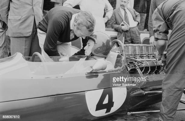 British Formula One racing driver Jim Clark on the Team Lotus Lotus 25 Climax V8 makes a pit stop during the British Grand Prix at Silverstone UK...