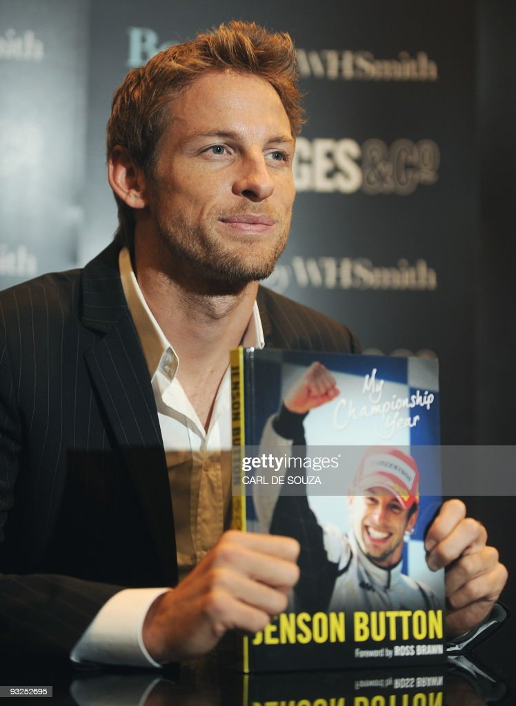 British Formula One World Champion racing driver Jenson Button is pictured at a book signing photocall in London on November 19 2009 Former Brawn GP...