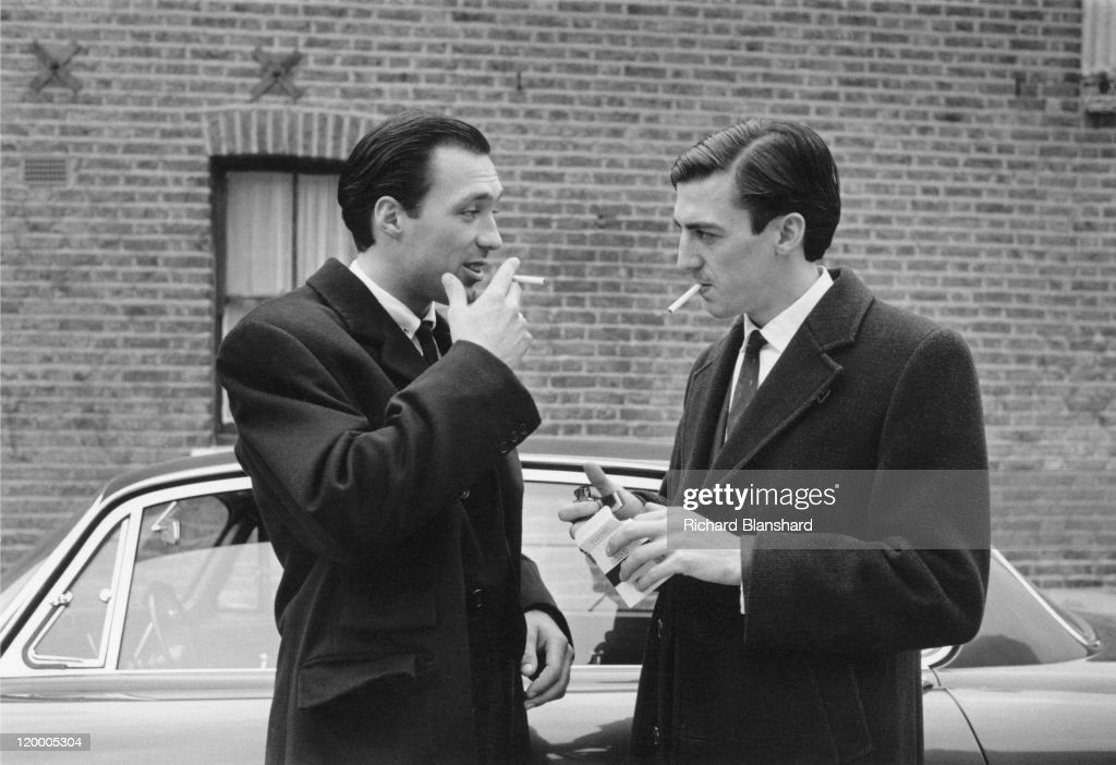 British gangster Reggie Kray, played by <a gi-track='captionPersonalityLinkClicked' href=/galleries/search?phrase=Martin+Kemp&family=editorial&specificpeople=213385 ng-click='$event.stopPropagation()'>Martin Kemp</a> (left), talks to a member of his gang in 'The Krays', directed by Peter Medak, 1990.