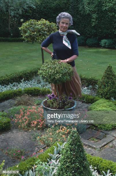 British gardening and landscape expert Alvilde LeesMilne stands in a backyard garden 1981