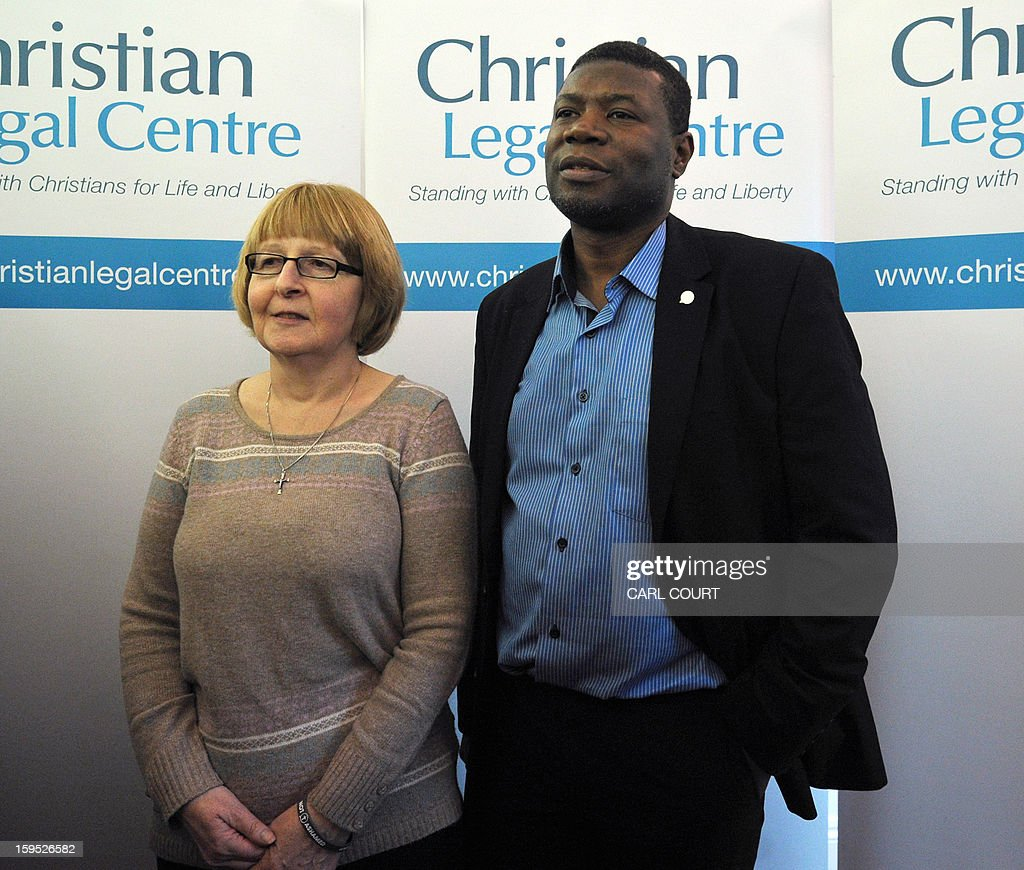 British Gary McFarlane, a marriage counselor in Bristol who was sacked for saying he objects to offering sex therapy to homosexuals, and Shirley Chaplin, a nurse who says she suffered discrimination at work over wearing a cross, pose for photographs in central London on January 15, 2013, after the European Court of Human Rights refused to rule that they suffered discrimination at work over their Christian beliefs. The ECHR judges rejected Chaplin's case on the grounds that the removal of her necklace was deemed necessary to protect the health and safety of nurses and patients.