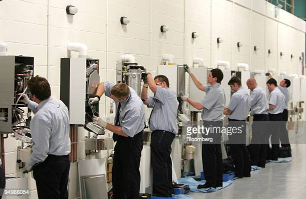 British Gas apprentices work on gas boilers while training at the British Gas Energy Academy in Leicester UK on Tuesday July 28 2009 Centrica Plc...