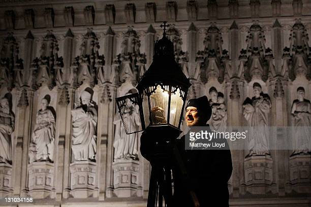British Gas engineer Martin Caulfield services and cleans a gas lamp in front of Westminster Abbey on October 31 2011 in London England Caulfield has...