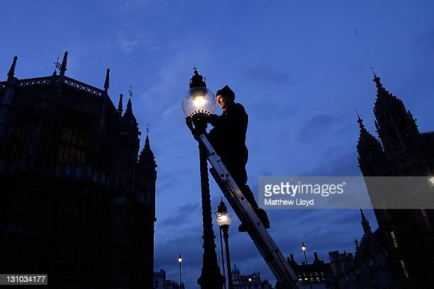 British Gas engineer Martin Caulfield services and cleans a gas lamp in Westminster on October 31 2011 in London England Caulfield has been looking...