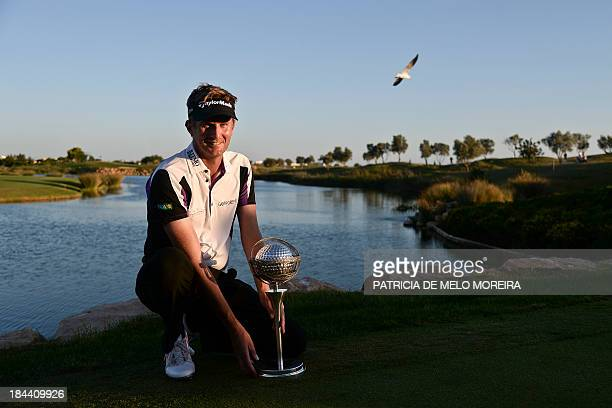 British golfer David Lynn poses with the trophy after winning the Portugal Masters golf tounament at Victoria Golf Course in Vilamoura southern...