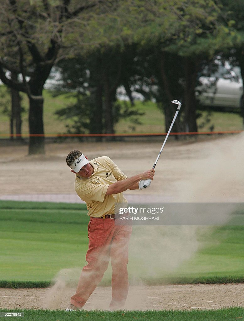 British golfer Lee Westwood hits the ball to the 16 hall during the third round of the Dubai Desert Classic golf tournament 05 March 2005.