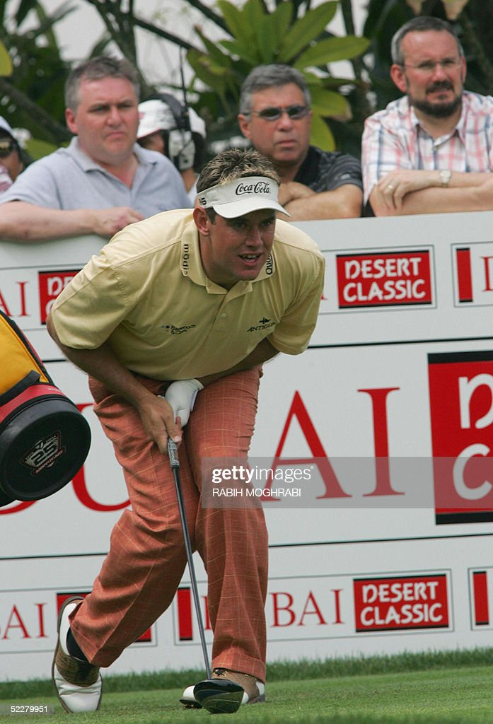 British golfer Lee Westwood watches his drive to the 17th tee during the third round of the Dubai Desert Classic golf tournament 05 March 2005.
