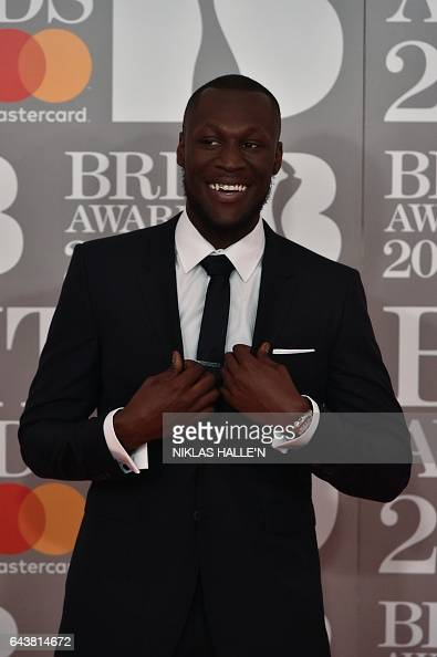 British grime and hiphop artist Stormzy poses on the red carpet arriving for the BRIT Awards 2017 in London on February 22 2017 / AFP / NIKLAS...
