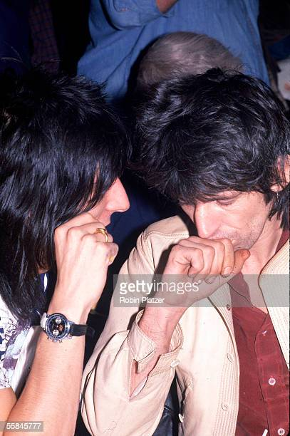 British guitarist Ronnie Wood of the rock and roll group the Rolling Stones speaks with his bandmate fellow guitarist Keith Richards at a press...