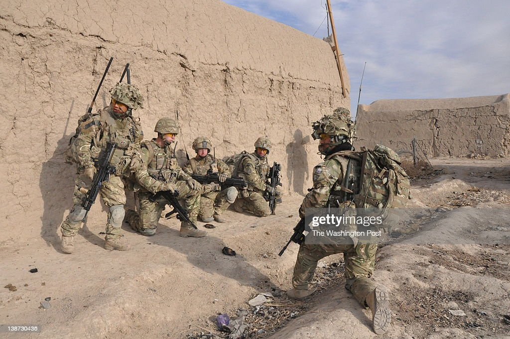 British Gurkha soldiers from the Yorkshire Regiment take positions outside a patrol base in the village of Khar Nikah in Nahre Saraj district Helmand...