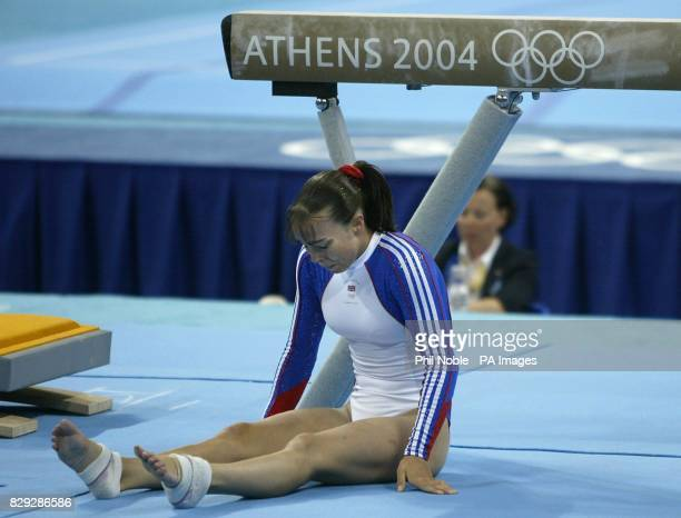 British gymnast Beth Tweddle sits on the floor after falling off the beam during the Women's Individual Artistic Gymnastics final at the Olympic...
