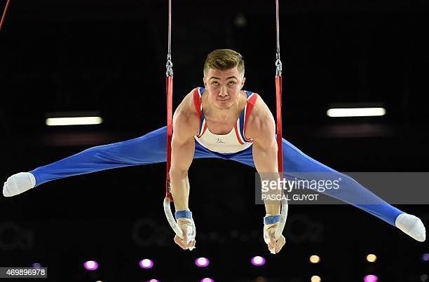 British gymnast Sam Oldham competes in a qualifying round of the Rings event of the European Men's Artistic Gymnastics Championships on April 16 2015...